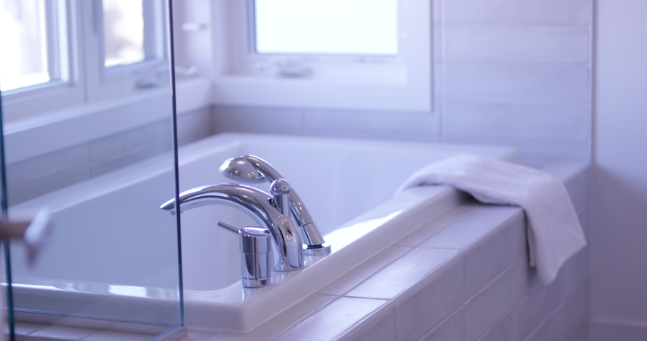 Modern bathroom with white bathtub - slow motion | Shutterstock HD Video #1031516057