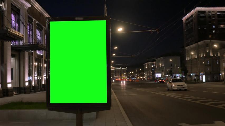 Modern citylight box with green empty screen at night | Shutterstock HD Video #1031580377