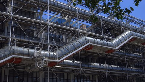 Paris, France - June 2019 :  Escalator of the Centre Pompidou Beaubourg in the center of Paris France, facade of the modern art and contempary museum with its famous escalator