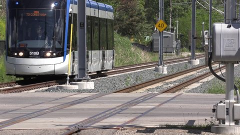 Waterloo, Ontario, Canada June 22 2019 Modern urban light rail transit system in Waterloo Canada with LRT vehicles for clean emissions free environmentally friendly commuting.