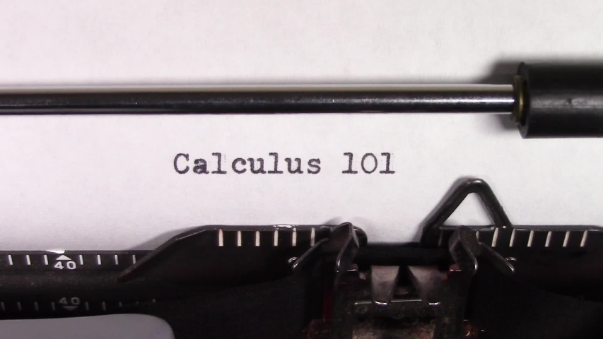 """A close up video of the words """"Calculus 101 """" being typed on white paper in an old manual typewriter. Shot in macro.   Shutterstock HD Video #1031830457"""