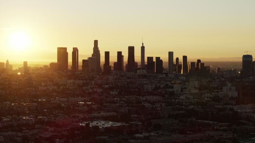 Aerial sunrise view with sun flare across Koreatown to LA financial district skyscrapers US Bank Tower California USA | Shutterstock HD Video #1032005627