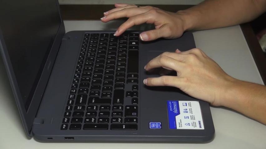 Using the laptop e entering in the keyboard.  Santos, Cidade/SP/Brasil - June, 26, 2019.  | Shutterstock HD Video #1032101717