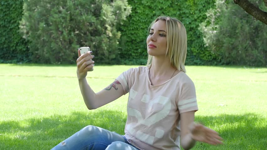 Busty Sexy Young Blonde Lying On The Grass In A Green Park Smile Stock Footage Video -9534