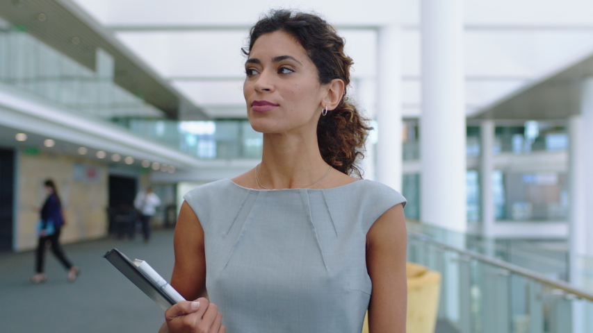 Confident business woman walking in airport smiling independent female executive enjoying successful corporate career 4k footage | Shutterstock HD Video #1032462617
