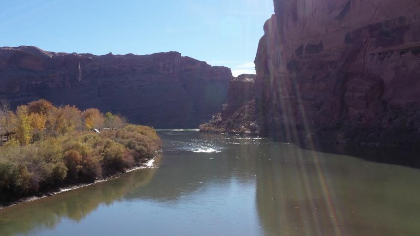 Dramatic aerial flying down river in Moab Utah | Shutterstock HD Video #1032498887