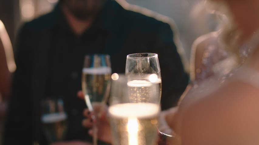 Group of friends celebrating glamorous party event drinking champagne wearing stylish fashion chatting at formal social gathering enjoying rooftop celebration 4k | Shutterstock HD Video #1032520247