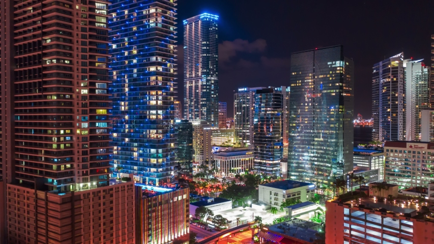 Aerial view of busy streets of Miami city, Downtown Miami financial district, Miami city hyperlapse, at night. Real Estate Miami downtown Shot on 4k camera.