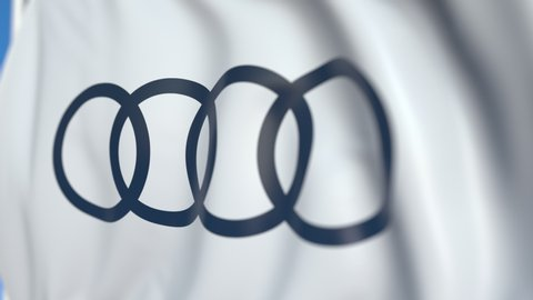 Flag with Audi logo, close-up. Conceptual editorial 3D animation