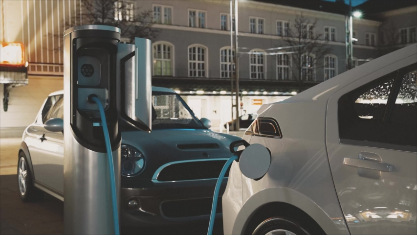Electric Car Charging At A Charging Station (evening)