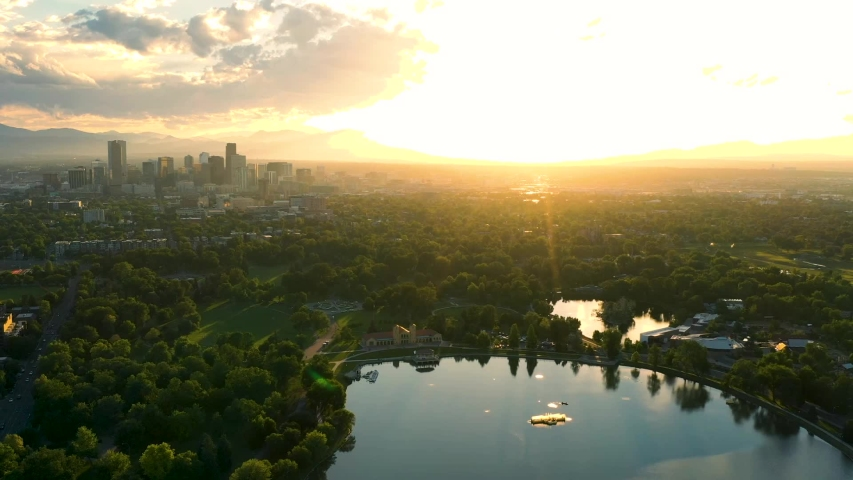 Aerial Drone Timelapse - Skyline of the city of Denver Colorado at sunset, from City Park.
