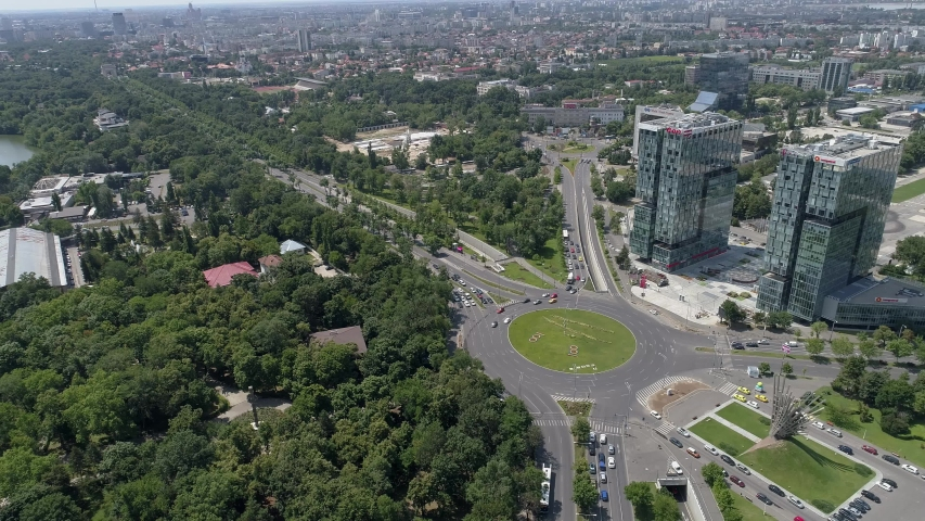 Aerial footage of the city of Bucharest at the House of Free Press and Herastrau Park