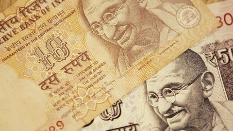 Mahatma Gandhi close up Indian currency 10/50/100 Indian rupees. Pedestal down shot