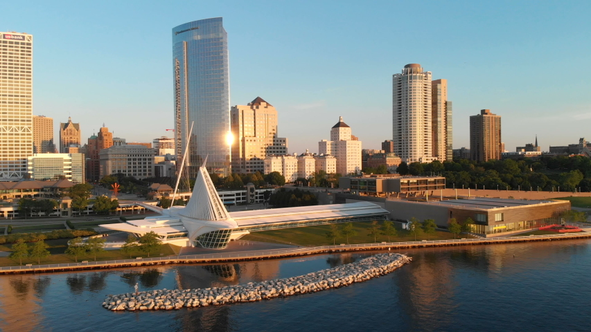 Aerial view of american city at dawn. High-rise  buildings, Michigan lake shoreline, Milwaukee Art Museum.  Sunny morning. Milwaukee, Wisconsin, USA | Shutterstock HD Video #1033246817