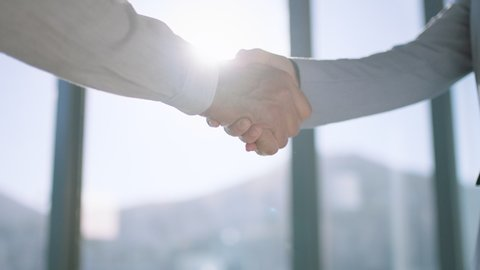 close up business people shaking hands successful corporate partnership deal welcoming opportunity for cooperation in office 4k footage