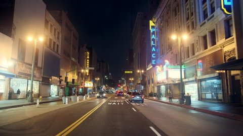 Los Angeles, CA / United States - 01 24 2019: POV driving on Broadway at Night, Downtown Los Angeles