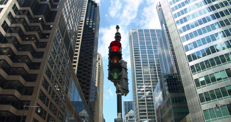 Chicago traffic light turns from red to green at downtown skyscrapers financial district intersection