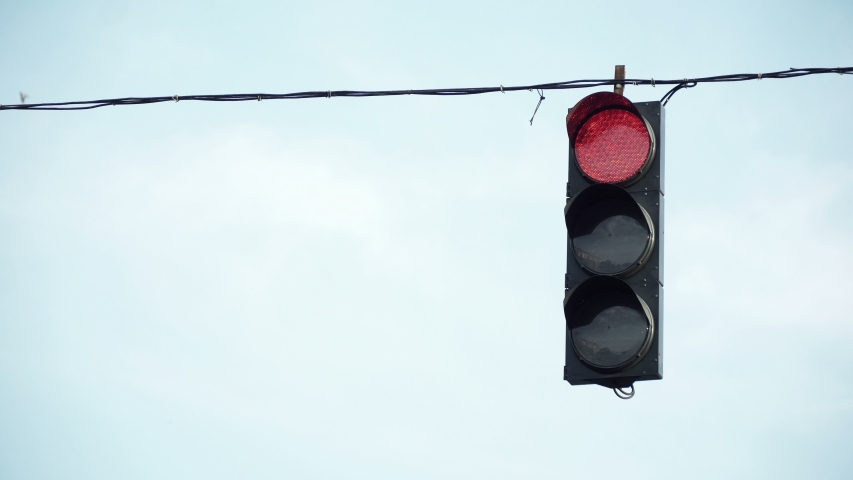 City traffic light hanging on the wire   Shutterstock HD Video #1033419287