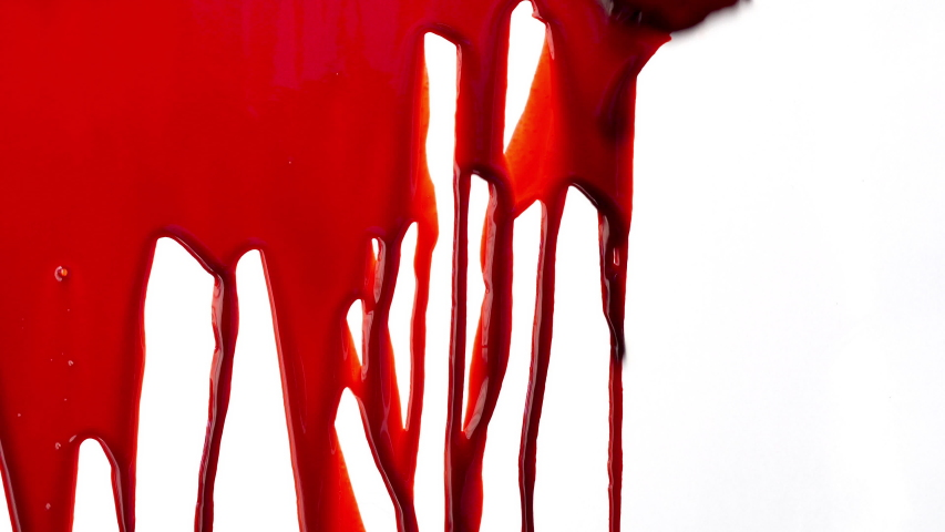 Streaks of blood pouring on a white surface  | Shutterstock HD Video #1033501487