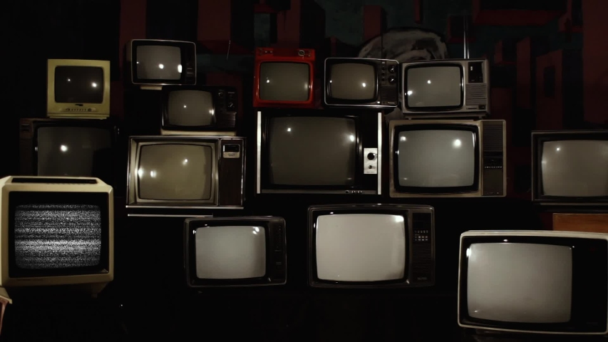 Retro TV Turning Off Green Screen over a Pile of Retro TVS from the 80s and 90s. Zoom Out Shot.  | Shutterstock HD Video #1033572437