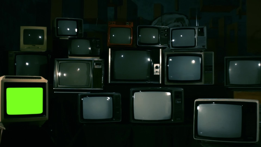 Retro TV Turning Off Green Screen over a Pile of Retro TVS from the 80s and 90s. Zoom Out Shot. Blue Steel Tone. | Shutterstock HD Video #1033572527