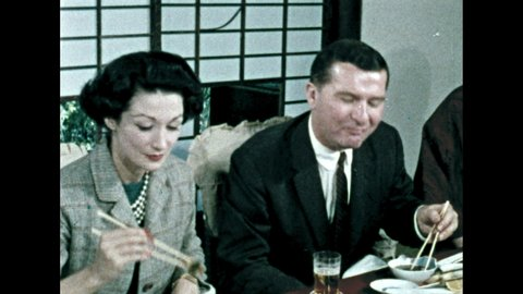 1960s: Man eats tempura. Man and woman talk and eat tempura.