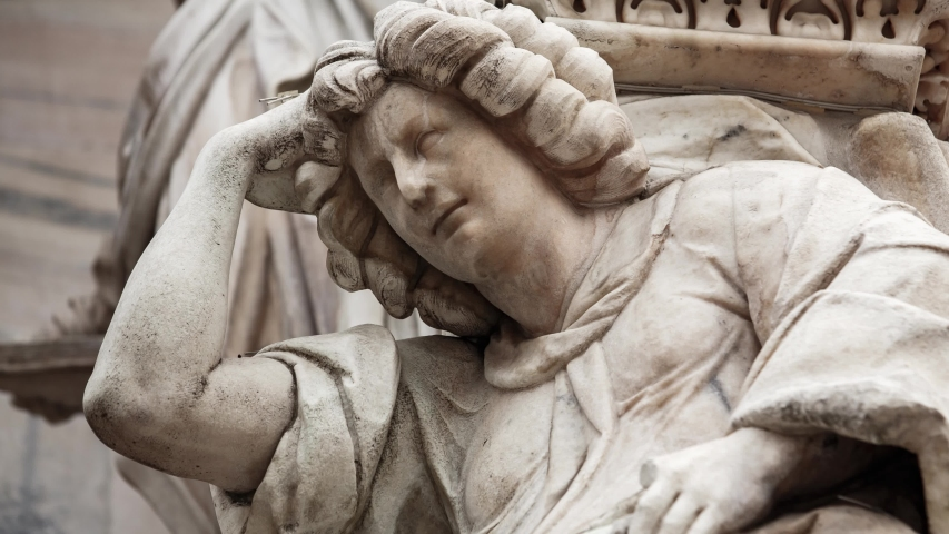 Beautiful Duomo di Milano in close up.White marble stone sculptures and statues in exterior design of ancient catholic church in center of Milan city in Italy.Gothic architecture style in details