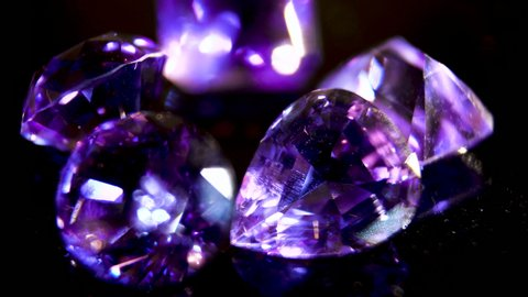 Close-up. Purple amethyst. The brilliance of the facets of a semi-precious purple crystal. Semiprecious stone. Precious stone