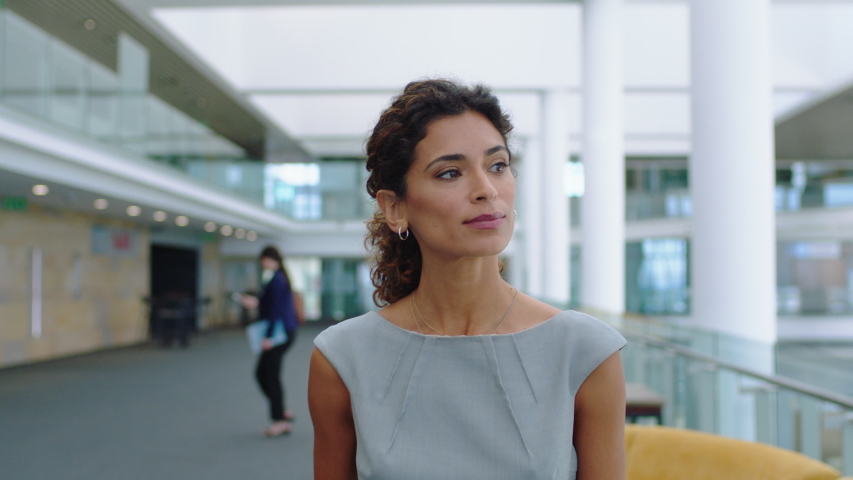 Confident business woman walking in airport smiling independent female executive enjoying successful corporate career 4k footage | Shutterstock HD Video #1034052317