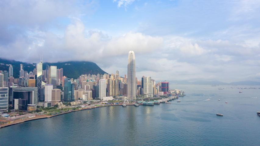 Aerial view hyperlapse 4k video of Victoria Harbour in Hong Kong. hyper lapse in hong kong city.  | Shutterstock HD Video #1034091827