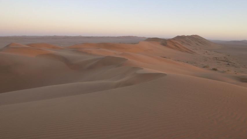 Pan across large Namib Desert red sand dunes wide angle #1034201057