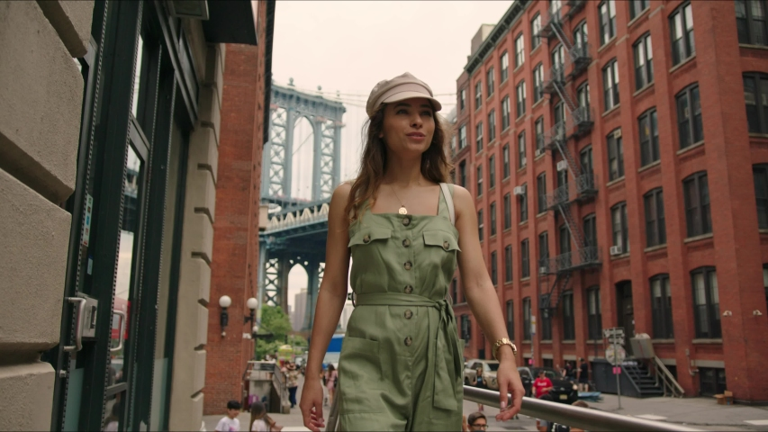 Pretty french lady walks around Manhattan. Moment from traveler's life. First time in New York. Famous views of big city. Enjoying the moment and feeling happy. | Shutterstock HD Video #1034429897