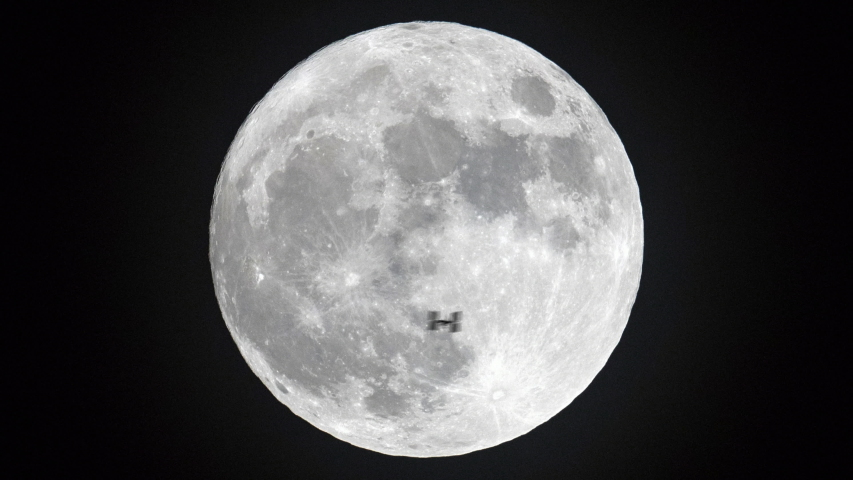 Incredible shot of International Space Station ISS flying past full moon   Shutterstock HD Video #1034869547
