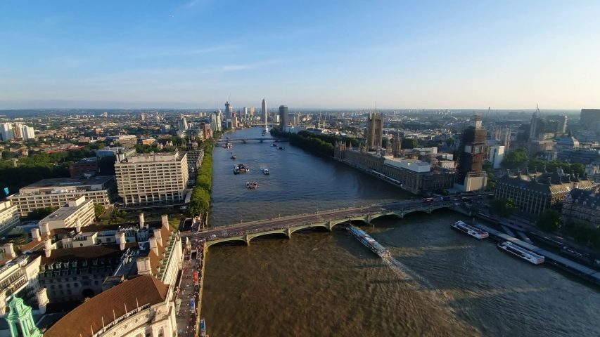 Aerial view of Westminster Bridge and River Thames in London, United Kingdom | Shutterstock HD Video #1034973227