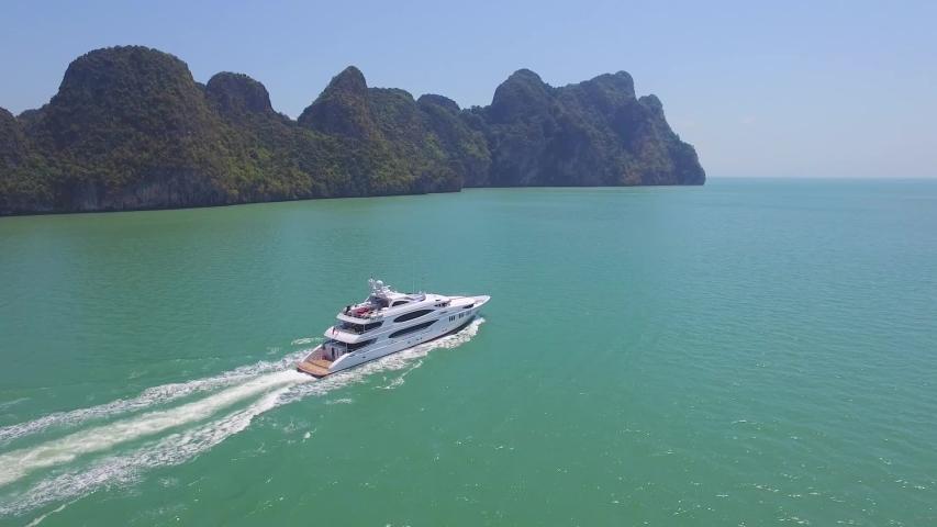Beautiful yacht cruises past islands | Shutterstock HD Video #1035133907