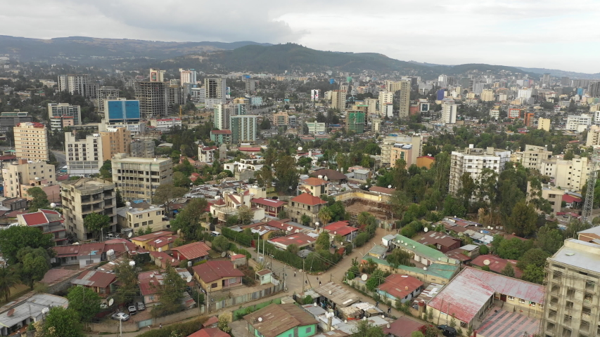 Drone flight over residential neighborhood in central district Addis Ababa, low-rise homes with corrugated sheets and development of apartment blocks, aerial footage Ethiopia Africa  | Shutterstock HD Video #1035157187