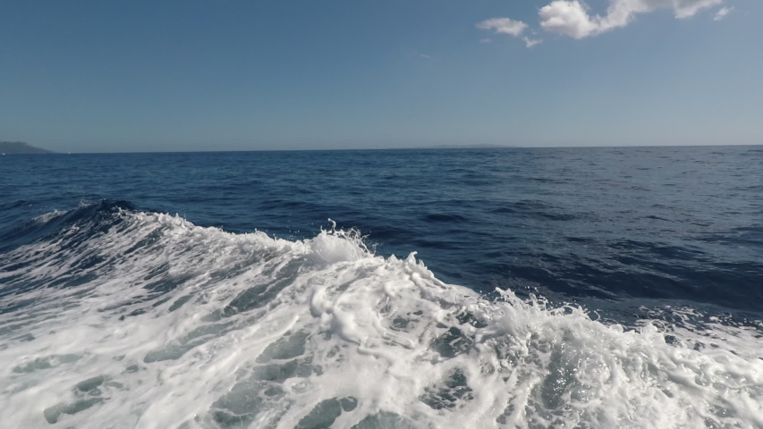 First person view from ship down the sea waves. Boat makes the water into beautiful foam wakes | Shutterstock HD Video #1035177467