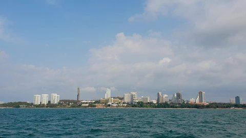 Pattaya, Thailand - June 28, 2019: Pattaya city skyline with buildings, skyscrapers, boat, sky and sea. Pattaya City has a population of 1,000,000.