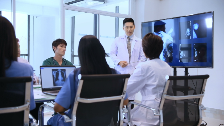 Medical concept. The doctor is presenting the work to the attendees to listen. | Shutterstock HD Video #1035410207