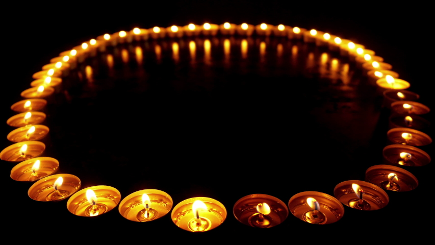 Candles up light. Color footage of some defocused yellow candles lighting.   Shutterstock HD Video #1035426497