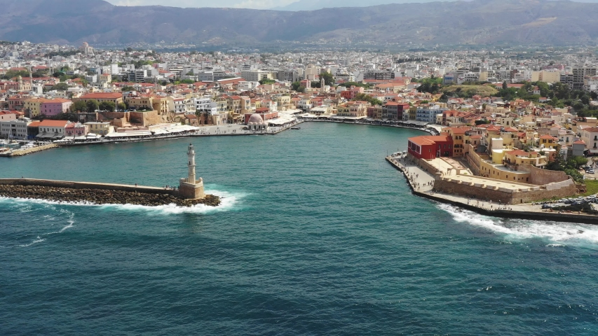 Aerial drone view video of iconic and picturesque Venetian old port of Chania with famous lighthouse and traditional character, Crete island, Greece. Architecture of the Venetian port in Chania. | Shutterstock HD Video #1035430517