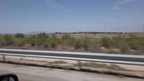 View of the landscape between Fes and Meknes scrolling on the highway in Morocco.