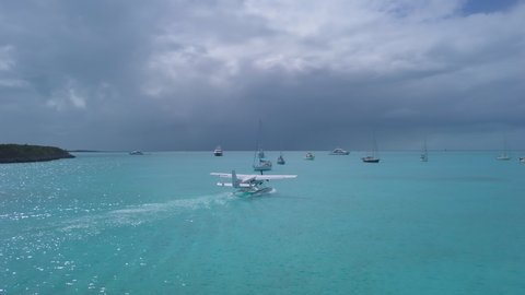 Exuma / bahamas - 06 12 2019: exuma, bahamas, 12 june 2019 - seaplane  departing tropical pig beach in the bahamas