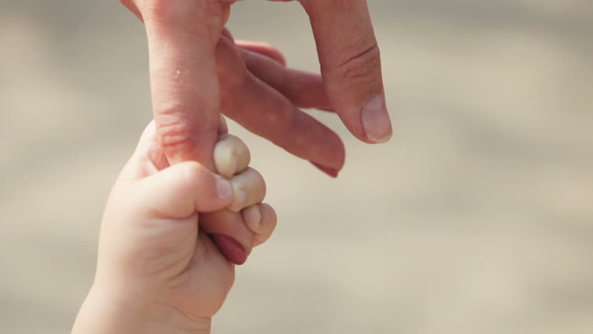 Finger mother in hand baby