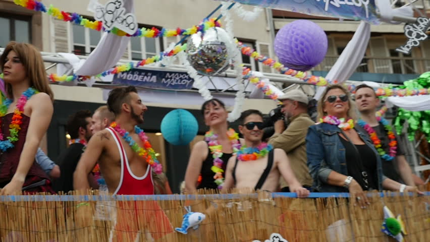 STRASBOURG - CIRCA 2015: People dancing in gay truck in slow motion at the 14th local edition of the Lesbian Gay Bisexual and Transgender LGBT visibility march, the Gay pride called Festi Gays