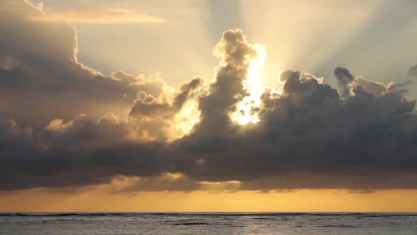 sunrise with clouds over water circa 2010 ws sun breaking through clouds over ocean stock