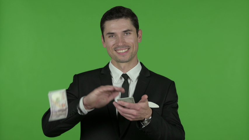 The Cheerful Young Businessman Throwing Money away against Chroma Key   Shutterstock HD Video #1036491557