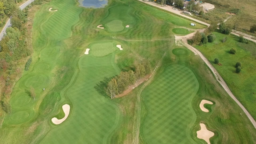 Aerial video of the Golf court, club. Lawnmower, Flatley | Shutterstock HD Video #1036676477