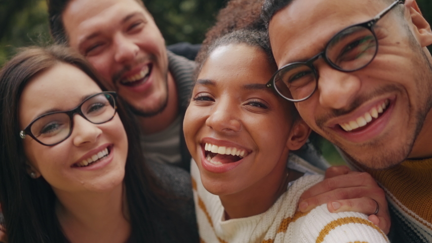Smiling African Brazilian American young woman posing with her friends and making funny faces in front of camera whilst taking a selfie   Shutterstock HD Video #1036749647