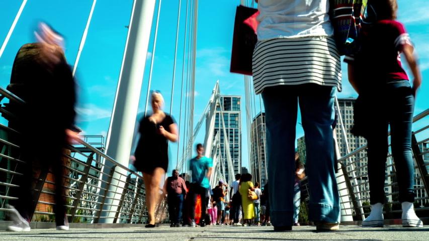 Time-lapse shot of people crossing waterloo foot bridge, london, with slow shutters peed to blur the people   Shutterstock HD Video #1036763987